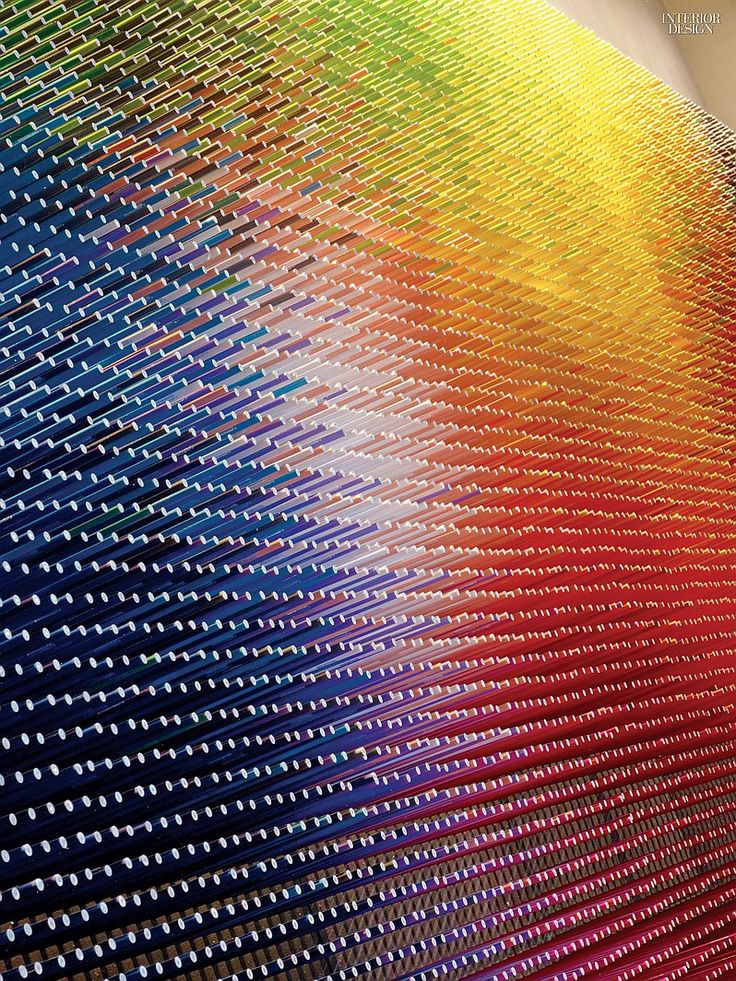 An installation of 12,000 colored pencils by BlackLab Architects animates the larger of two party rooms inside Midtown's 312-unit rental property, Abington house. Photography by Eric Laignel.