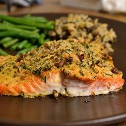 Baked salmon coated in a crunchy pecan-maple topping is a very tasty dinner that fits into a paleo-, gluten-free, and dairy-free lifestyle.