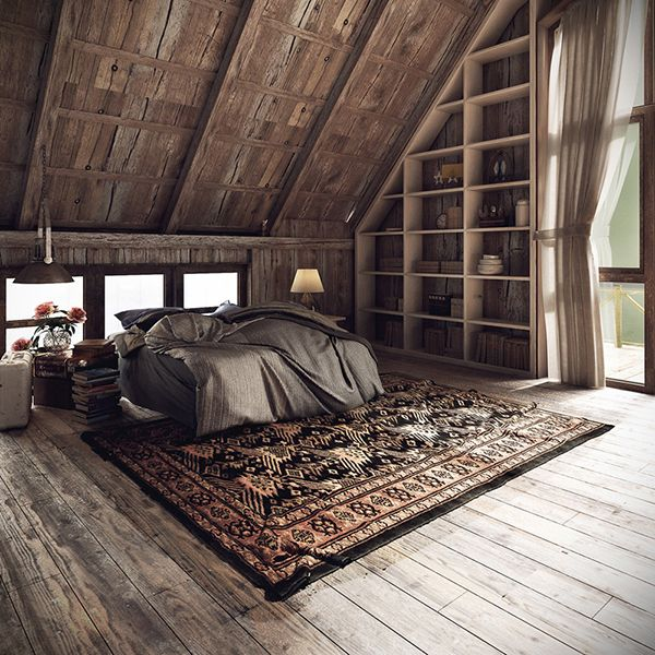 Gorgeous bedroom with wood floor, slopes ceiling, traditional rug under bed