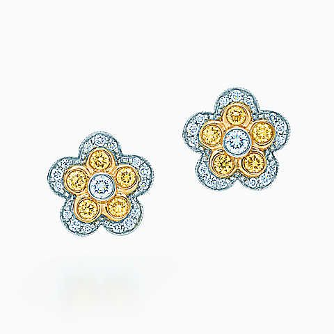 Flower earrings of platinum and 18k gold with yellow and white diamonds.