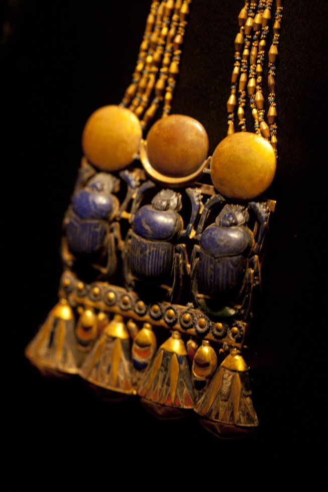 Pectoral with Three Scarabs | This necklace of gold, lapis lazuli, and semiprecious stones was one of about 150 pieces that adorned the mummy of King Tutankhamun