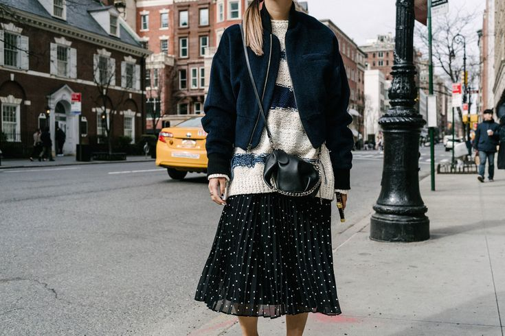 Cienne NY Jacket, Tomorrowland Sweater, Sézane Skirt, The Row Shoes, Loewe Bag, Louis Vuitton Case, COS Beanie