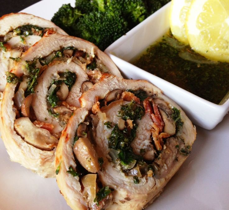 A pork tenderloin stuffed with mushroom, onion, garlic, spinach and bacon and roasted in the oven. Served with a delicious lemon parsley oil drizzle. Paleo, gluten-free.