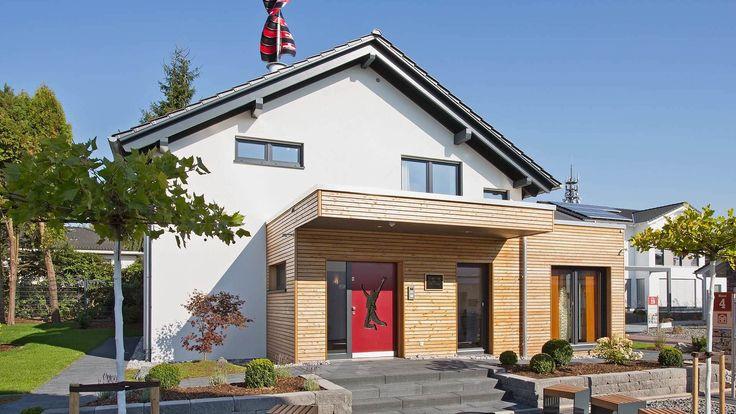 Fingerhut Einfamilienhaus dunkles Satteldachhaus weiß verputzt graue Fenster Holzverschalung Eingangsbereich rote Haustür