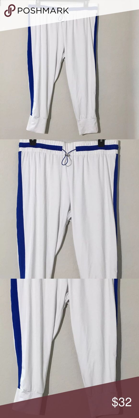 """Fabletics Victoria Cropped Pants White Blue XXL Women's Fabletics Victoria cropped pants whit with blue stripe down side. Sz XXL SOLD OUT online! Measurements 18"""" waist laying flat, 25"""" inseam. Excellent condition slight piling on inner thighs See Pictures Fabletics Pants Ankle & Cropped"""