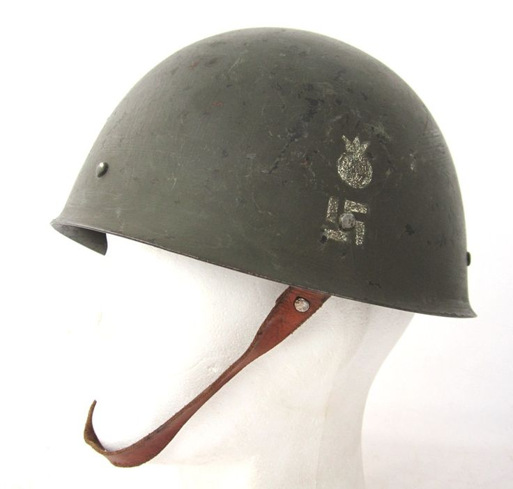 WW2 Finnish army M40 steelhelmet. Helmet right side with white painted Heavy Anti-aircraft artillery troop emblem.