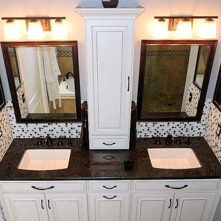 Small storage between vanities. Maybe hide electrical outlet in the small drawer on bottom.