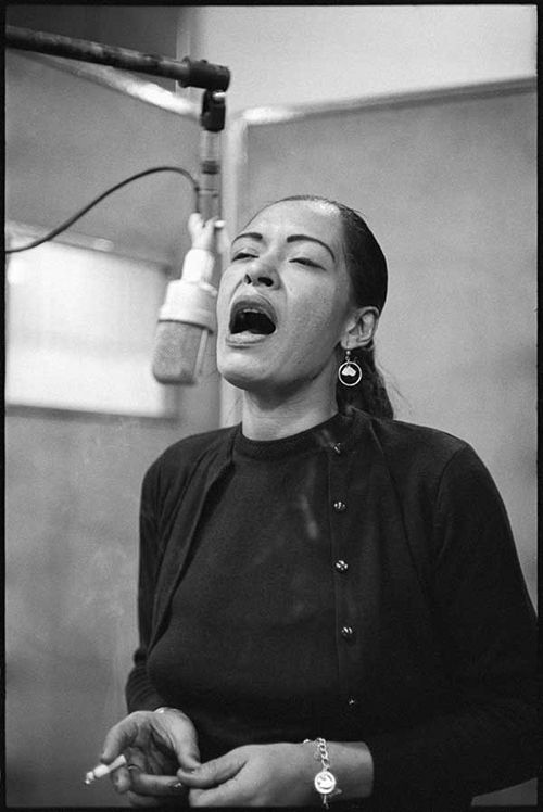 Billie Holiday on stage during a jam session in March 1954. Description from pinterest.com. I searched for this on bing.com/images