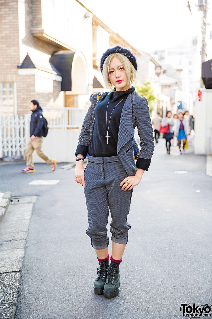Yuri - the designer of the Japanese brand CuLLt - on the street in Harajuku wearing a CuLLt cross necklace with items from Vivienne Westwood, Dr. Martens, and H&M.