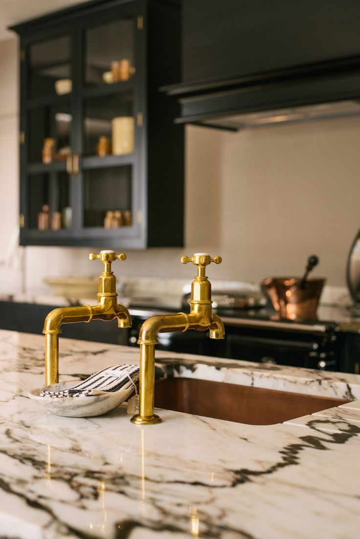 deVOL Aged Brass taps, San Simone quartzite worktops and a beautiful copper sink look so cool in our new Millhouse kitchen showroom at Cotes Mill