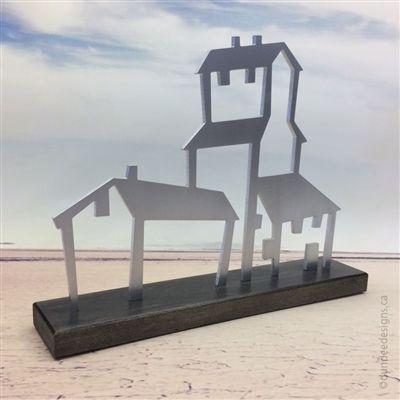 Elevator sculpture, aluminum with maple base. Artist: Shirley Lloyd-Davies/Dundee Designs Inc.