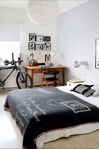Black and white bedroom with desk - cool blanket!