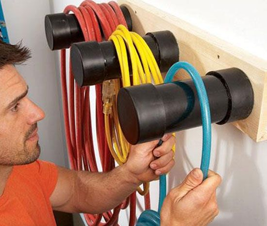 Use PVC pipe to create hose or electrical cord hanging storage.
