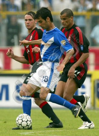 Spanish midfielder Josep Guardiola (Brescia, centre) is pursued by Brazilian striker Rivaldo (AC Milan, right) and Argentinian midfielder Fernando Redondo (AC Milan, left) during their Italian Serie A football match at the Brescia Mario Rigamonti stadium, Italy, Saturday, 10 May 2003.