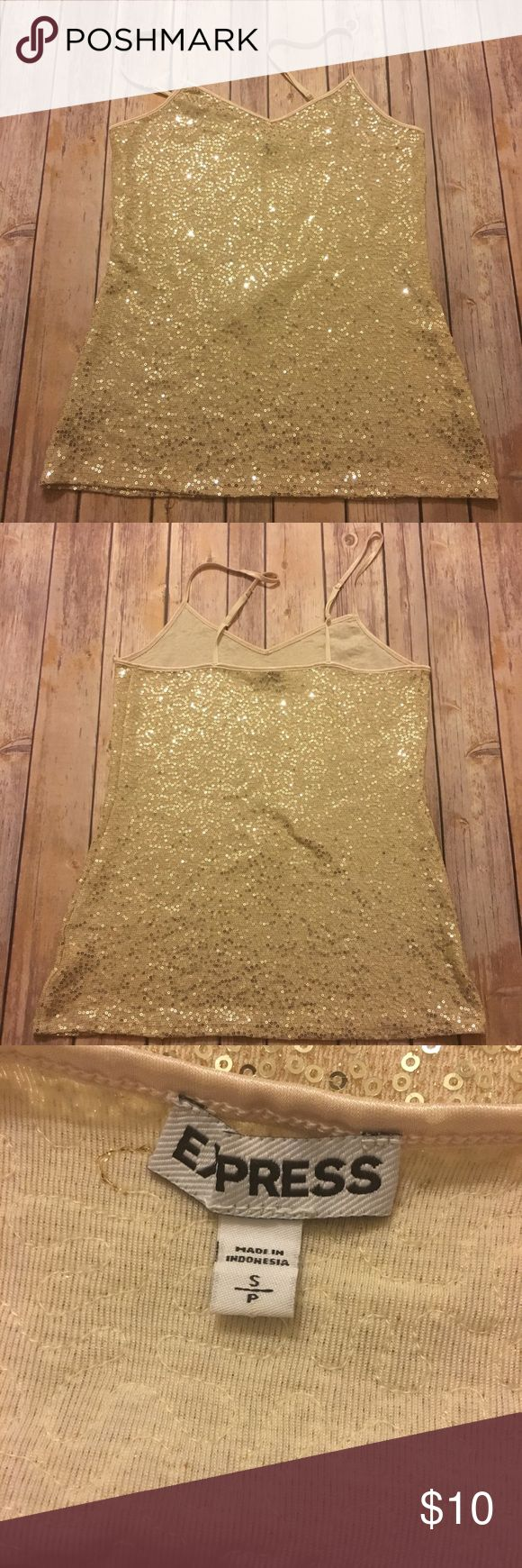 Gold Sequin Cami Sparkly gold sequin cami with a v neck, adjustable straps. Wear it under a navy blazer or pair with gold sequin shorts and be 🔥🔥🔥 Happy to discount bundles or trade!!! Express Tops Camisoles