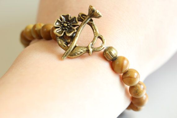 Brown Jade Beaded Bracelet with Bronze Flower by MoniqueUniquely