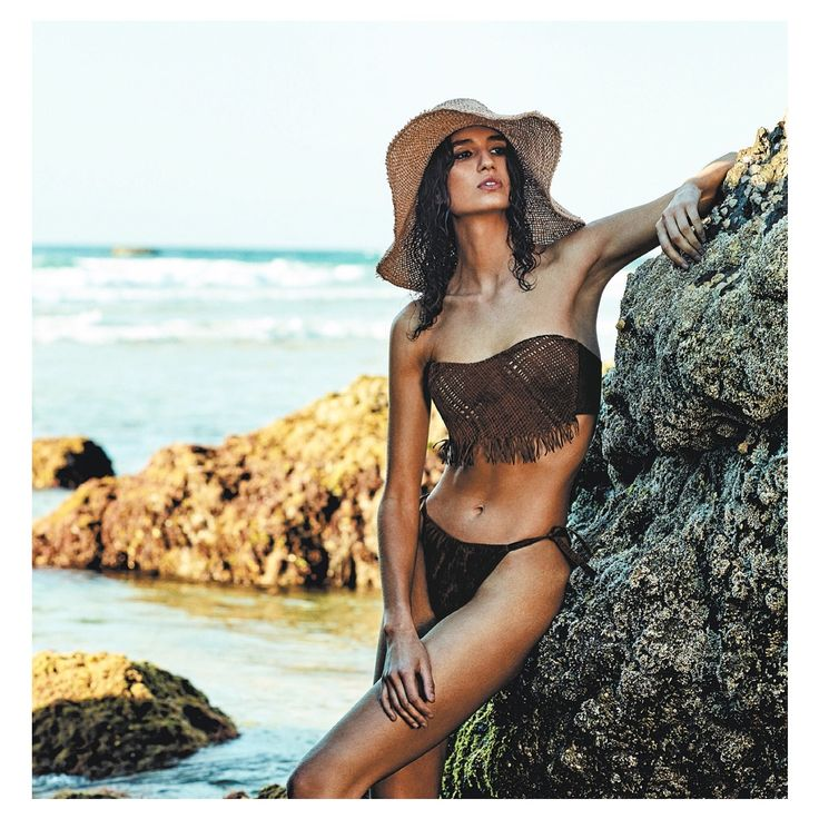 Byron Bay Beach Babe, wearing Hatmaker in Sunday Life Magazine #hatmaker #byronbay #aussiesummer #sunhat #jonathanhoward www.hatmaker.com.au