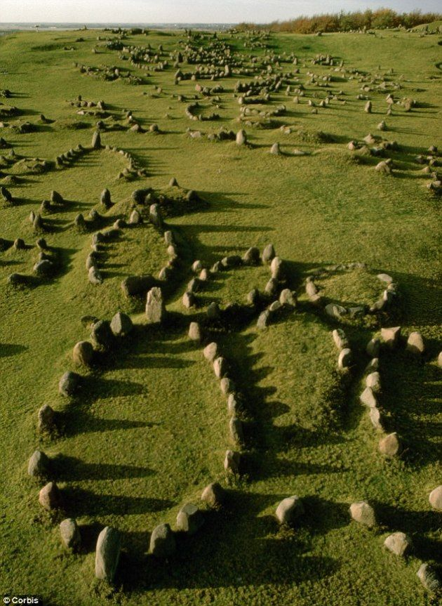Aerial view of Lindholm Hoje, a Viking cemetery in Denmark close to the city of Aalborg. From this angle you can clearly see the stone grave markers which surround many burials with the symbolic silhouette of a ship. Like many other Indo-European cultures, the Vikings often associated death with a journey over water, an ships were also very important in daily life.