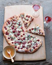 Rosemary Flatbread with Blue Cheese, Grapes and Honey | This crusty flatbread is studded with creamy crumbled blue cheese and sweet table grapes.