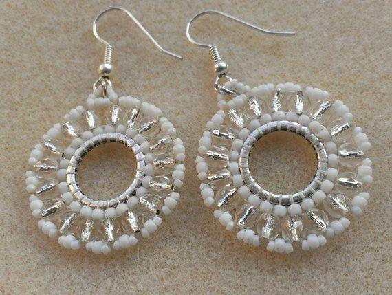 """""""Frozen"""" snowflake earrings: https://www.etsy.com/listing/213085990/snowflake-frozen-beaded-hoop-earrings"""