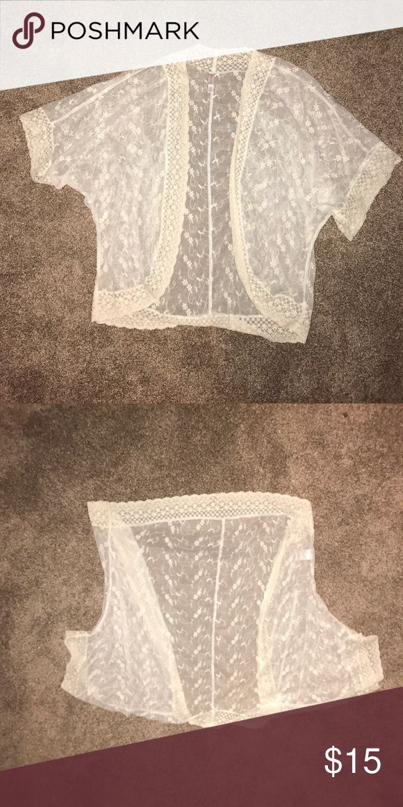 Sheer white kimono Adorable lace kimono. Perfect for a bathing suit cover up or to pair with a cami in the summer. Goes to about your waist Xhilaration Tops Blouses
