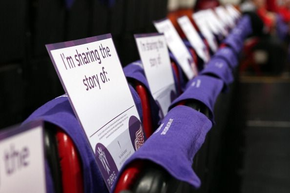Signs and purple towels were given to all the fans attending the Detroit Red Wings game for #HockeyFights Cancer night at Joe Louis Arena.
