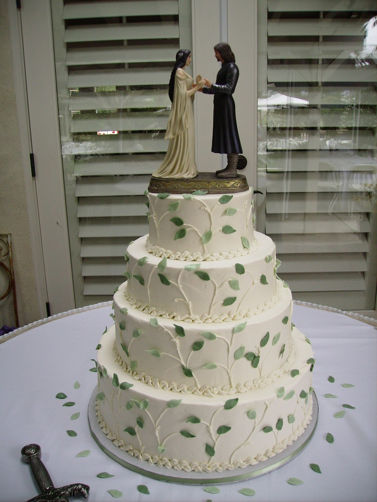 White Wedding Cake Covered In Green Leaves