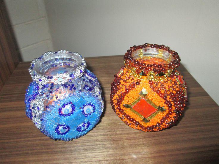 Antiguos frascos de mermeladas reutilizados como portavelas estilo marroquí, decorados con mostacillas y abalorios...$12.000 el par