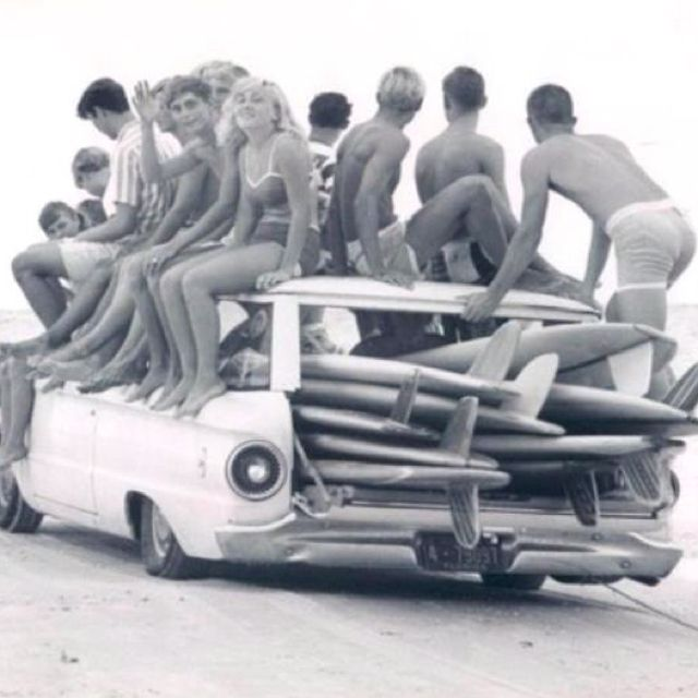 Mid 60's - Lets go surfing! ... If I'm not mistaken, that's a Ford Falcon Station Wagon under all those kids & surfboards.