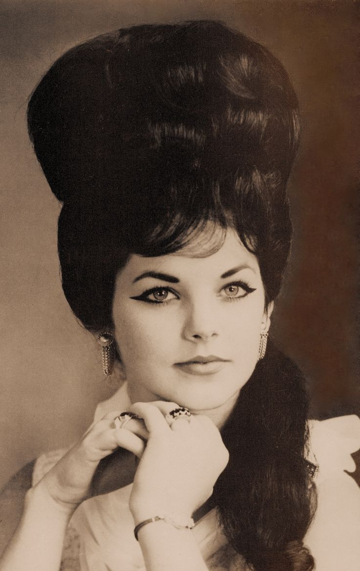Priscilla Presley mid 60's. Elvis modelled Priscilla on his ideal of what a woman should look like, like Cleopatra with a Ronettes style beehive hairdoo. She had to die her brunette hair with the same dye naturally blonde Elvis used, Clairol Black Velvet, & wear black eyeliner, false eyelashes and heavy pancake. photo from ELVIS WORLD by Jane & Michael Stern 1987 (minkshmink)