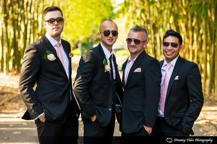 Groomsmen in Suits and sunnies at Brisbane Botanical Gardens