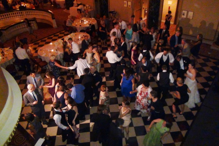 This is a great view of the dance floor from the School of the Art Institute ballroom's huge wrap-around balcony. Your wedding can be this fun with a Chicago Wedding DJ from Fourth Estate Audio. Just click http://www.discjockey.org to get started.