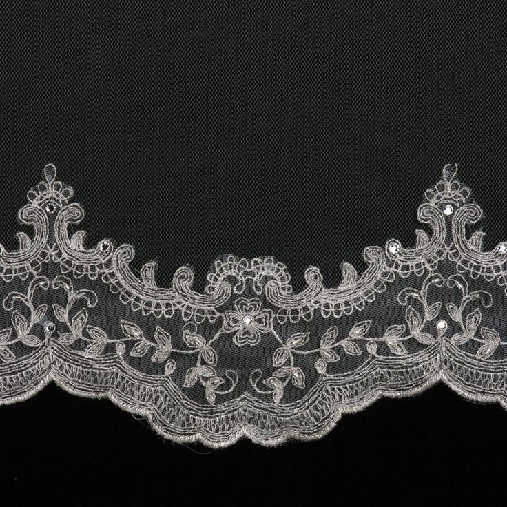 An exquisite silver embroidered wedding veil with a few rhinestone accents. This is a very beautiful veil if you are looking for a modern lace look. It is available in fingertip length 41 inches and 7