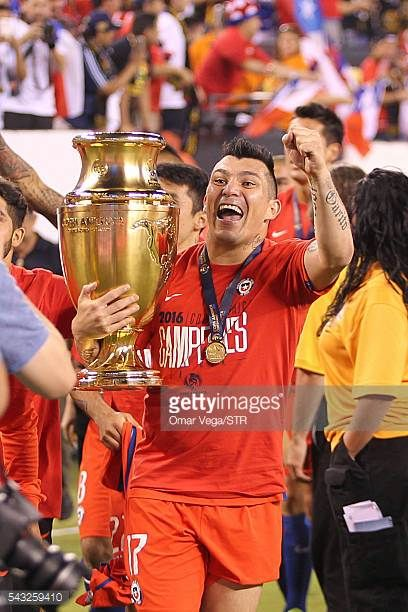 Gary Medel of Chile celebrates with the trophy after winning the championship match between Argentina and Chile at MetLife Stadium as part of Copa...