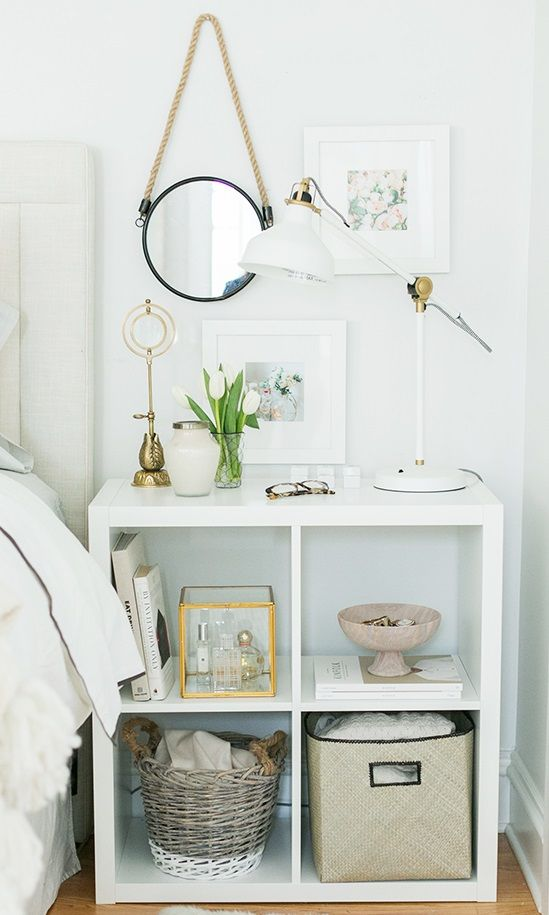 A simple storage cube unit painted to match your bedroom can become a nightstand for housing jewelry, books, slippers, etc.
