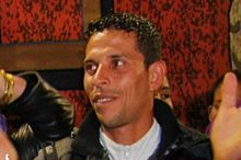 Mohamed Bouazizi (1984-2011)  a Tunisian street vendor who set himself on fire on 17 December 2010, in response to the confiscation of his wares and the harassment and humiliation that he said was inflicted on him by a municipal official and her aides. This act became a catalyst for the Tunisian Revolution..