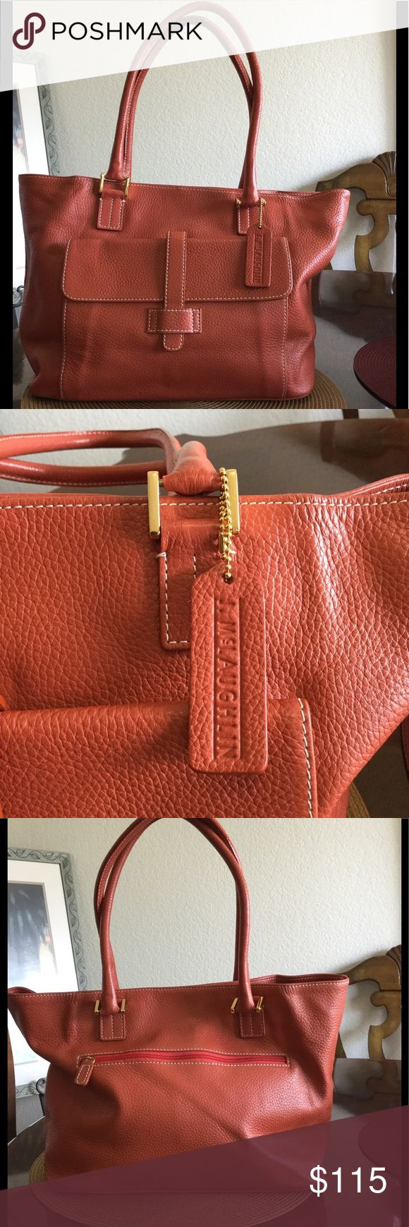 "J. McLAUGHLIN Orange Leather Tote Gorgeous, gorgeous orange leather tote by J. McLAUGHLIN. Double strap drop 10"" with gold hardware, magnetic closure with zipper pocket in the back and large flap pocket in the front. Pebble leather is so soft! Inside has one zipper pocket and two slot pockets. Four feet on the bottom, in great shape. Tuck the corner for a whole new look! Please see photos with interior stains and outside blemish. Perfect roomy bag for all of your essentials! J. McLaughlin…"