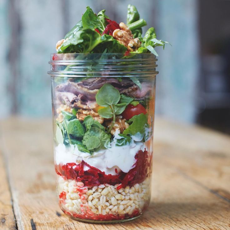 Portable jam jar salads make delicious, colourful lunches that will cause massive office envy!! There are 4 versions of these jars in Everyday Superfood for when you are on the go or at work, all of them layered up with carb, protein, veg and a little dairy for a super balanced and healthy meal #JamiesSuperfood