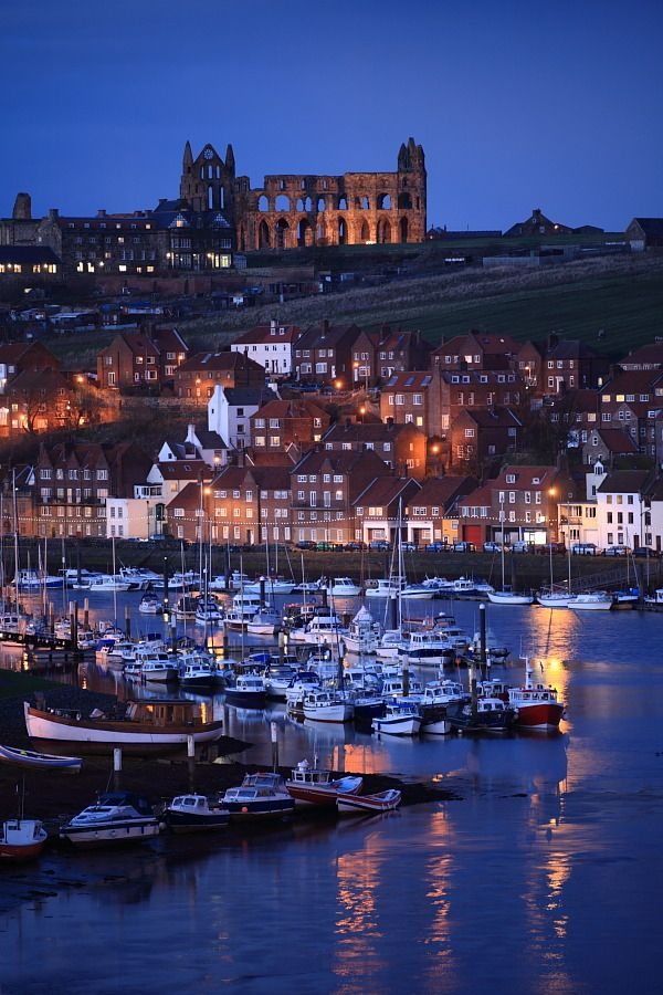 Whitby Harbour with the ruined Abbey beyond. North Yorkshire, England