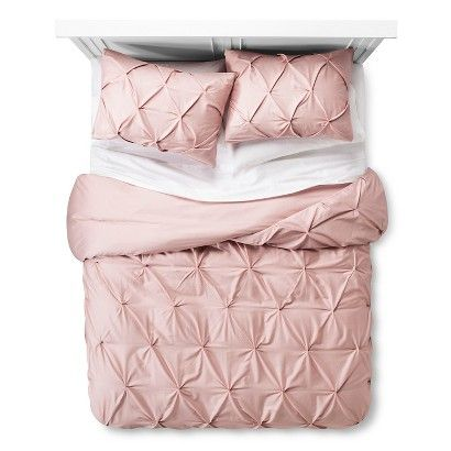 Add a subtle touch of textural dimension to enhance your bedroom décor with the Pinched Pleat Duvet Cover Set from Threshold™. This 3-piece bedding set has a duvet cover and 2 shams. The pleated fabric is made of 100% cotton with multiple pin tucks for ultimate softness and texture. The cover in this bedding set has hidden buttons to keep the duvet in place. Available in standard sizes in a variety of colors. Machine washable.