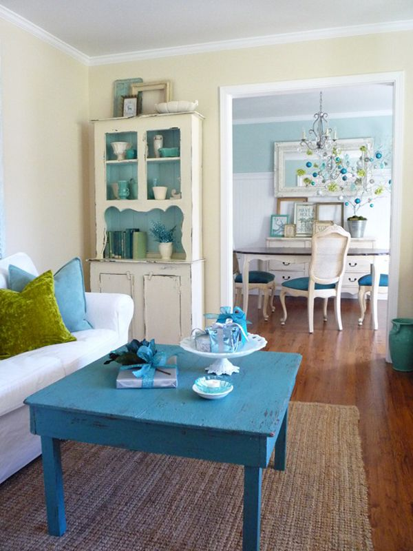 Repainted table used as coffee table. The color chosen is magnificent. It matches the chair seats of the chairs in the next room. And look at the lovely corner cabinet, with the interior painted blue. Great use of flea market finds. Biddy Craft