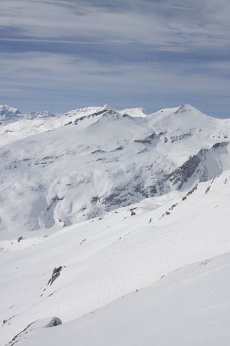 View taken of the mountain slopes of Vorab Glacier Gletscher above Laax, Graubunden, Switzerland, covered in snow with the winter sun glistening on the slopes ©Gregory Goldston