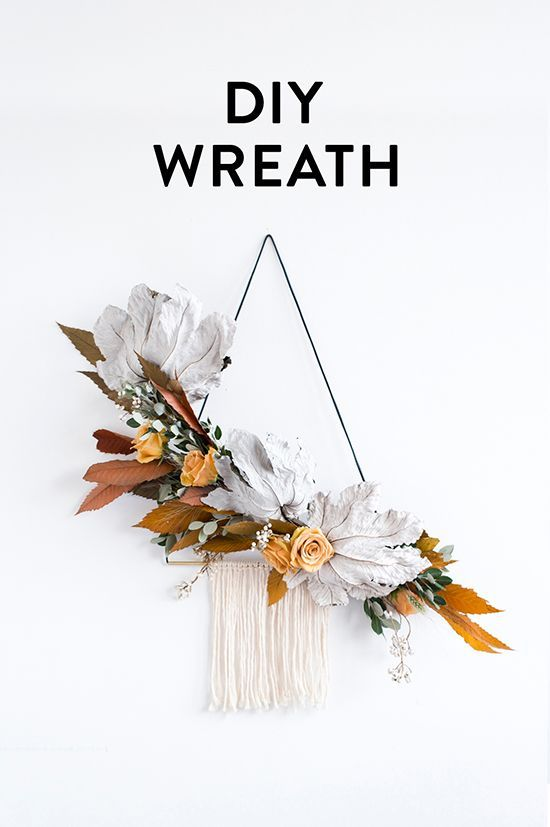DIY wall hanging wreath and wall hanging. This DIY is a beautiful way to incorporate some fall foliage into your home.