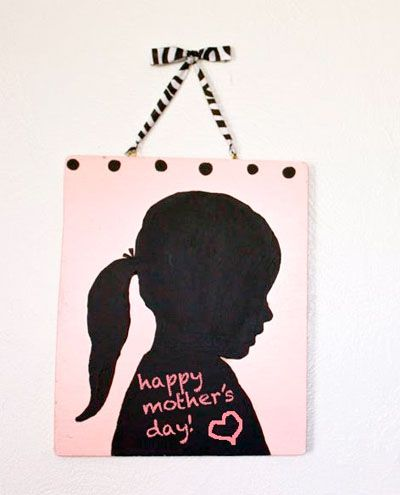 this is precious...silhouette of a child or grandchild for mothers/fathers day! this one is with chalkboard paints, but im sure you can use other kinds too!