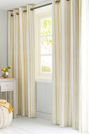 Buy Cotton Rich Ochre Ditsy Eyelet Curtains from the Next UK online shop