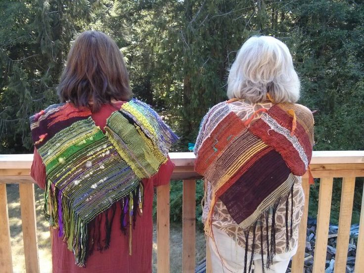 Two mobius scarves, being worn poncho style.