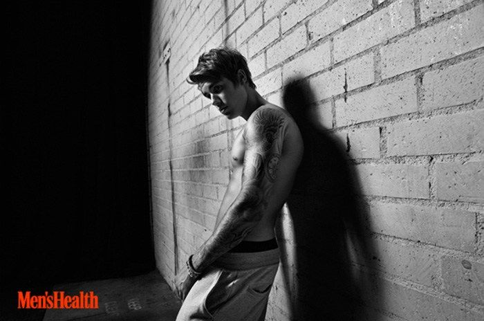 """Justin Bieber continues to make headlines as he covers the April 2015 issue of Men's Health. An unlikely cover star for the men's fitness magazine, the 21 year-old singer is photographed by Peter Hapak for the gym photo shoot. Addressing criticism from the magazine's loyal readership, Men's Health editor-in-chief Bill Phillips shares, """"Our cover guys...[ReadMore]"""
