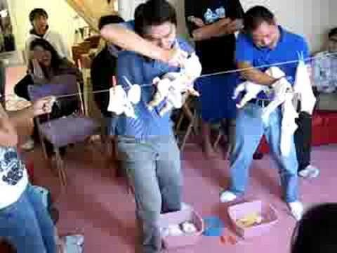 Funny game for the guys.  Give the men at your baby shower a taste of what Moms do with this clothesline game. Dads/men must hold the telephone, and the baby, while hanging baby clothes on a clothesline