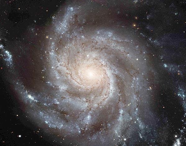 Foto's gemaakt door de Hubble-telescoop (© NASA/Reuters) Messier 101, een spiraalvormig sterrenstelsel.