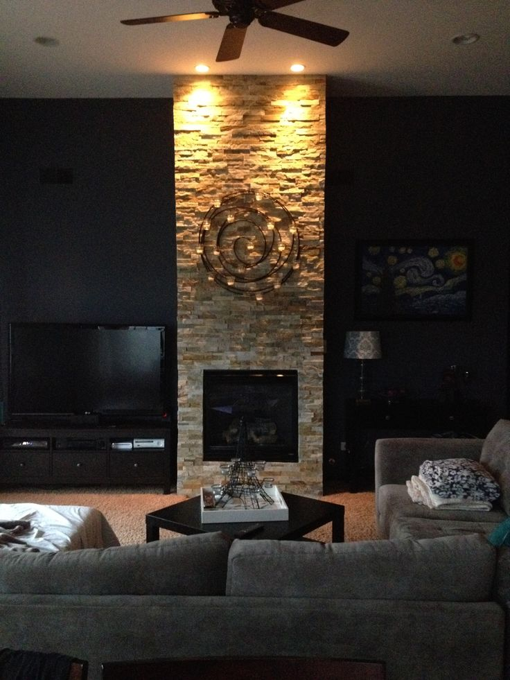 Stone fire place! This was a simple project and cost us about $300. We also sealed it with a non gloss sealer to bring out the stone. Looks incredible and great added value to your home. Tools needed - Wet saw, screw gun and a tape measure.